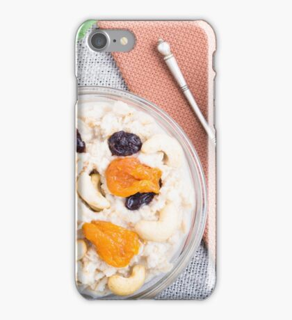 Top view of oatmeal porridge with raisins, cashews and dried apricots  iPhone Case/Skin