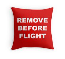 Remove Before Flight warning in white letters Throw Pillow