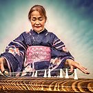 Harumi playing the Koto by Geoff Carpenter