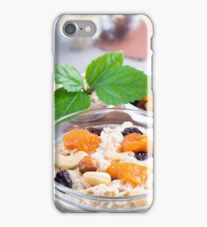 One portion of oatmeal with fruit and berries in a glass iPhone Case/Skin