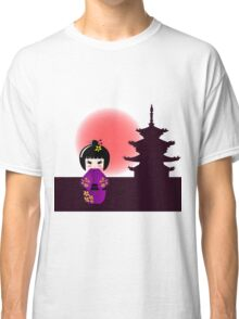 Japanese kokeshi doll at temple during sunset Classic T-Shirt