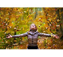 Young lady throwing up leaves Photographic Print