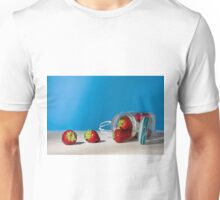 Strawberries and a glass jar full of strawberries lying down on a table Unisex T-Shirt