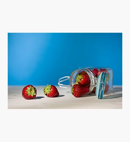 Strawberries and a glass jar full of strawberries lying down on a table Photographic Print