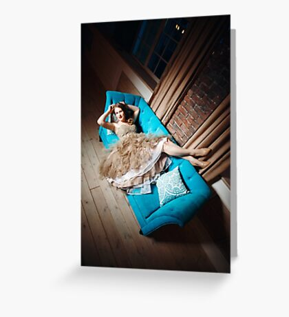 Beautiful Laughing Woman Lying on Blue Couch Greeting Card