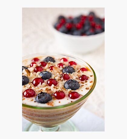 Closeup of a yogurt dessert with berries and almonds Photographic Print