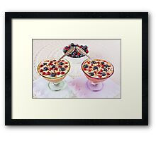 Two yogurt dessert with berries, almonds and spoons Framed Print