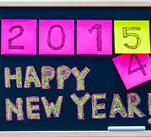 Happy New Year 2015 message hand written on blackboard by Stanciuc