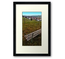 Bench with a village view | landscape photography Framed Print