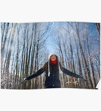Young woman playing with snow Poster