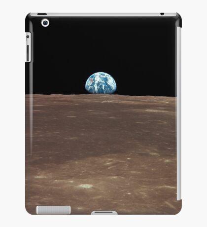 Earth rising above the Moon's horizon. iPad Case/Skin