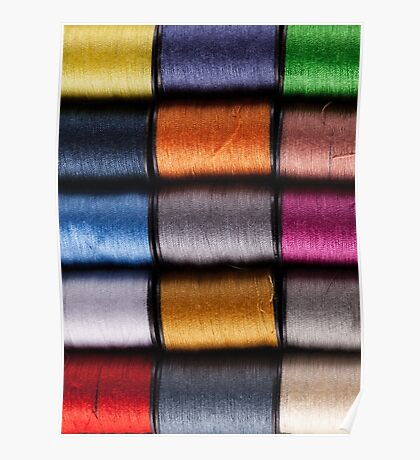 Colorful cotton reels lined up in a row Poster