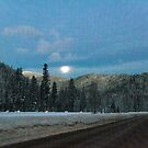 Wolf Moon over Lookout Pass by Bryan D. Spellman
