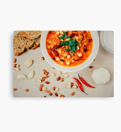 Chili Beans Stew, Bread, Red Chili Pepper And Garlic Ready To Be Served Canvas Print