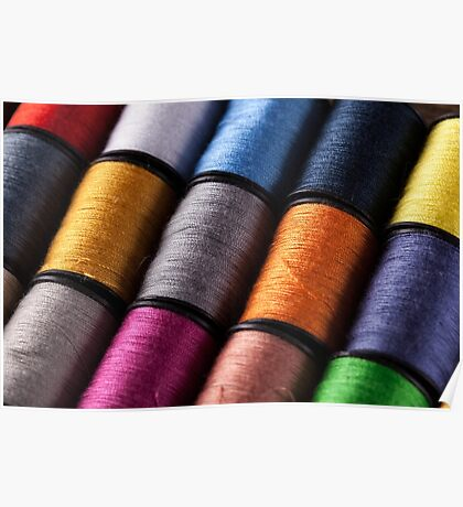 Colorful cotton reels on an angle Poster