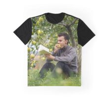 Teenager reading a book in the orchard Graphic T-Shirt