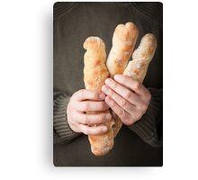 Man holding baguettes Canvas Print