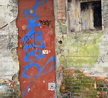 Old rusty WWII bunker door with graffiti by walstraasart