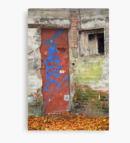 Old rusty WWII bunker door with graffiti Canvas Print
