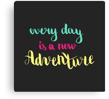 Every day is a new adventure. Colorful text on dark background. Canvas Print