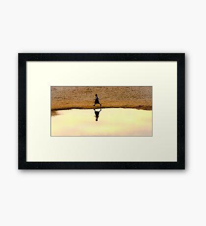 Little Girl on the Beach Framed Print
