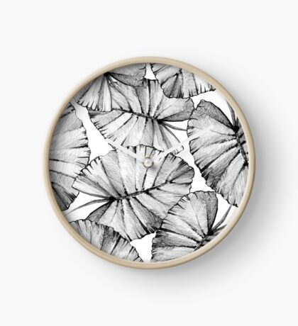 Graphic pattern with leaves. Clock