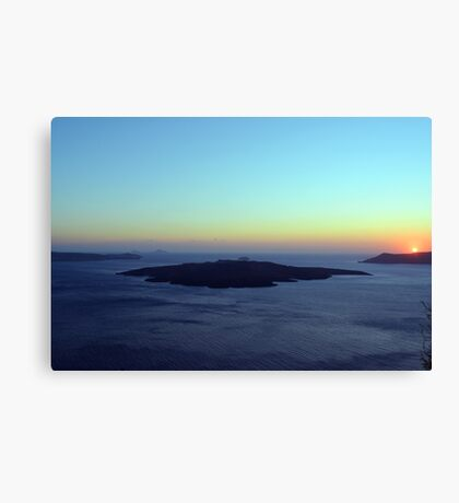 The Aegean Sea at sunset in Santorini, Greece Canvas Print