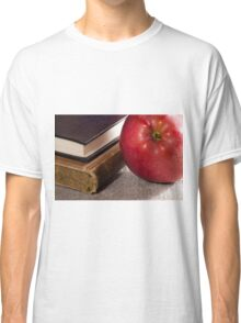 Detail of old books in hardcover and close-up red apple Classic T-Shirt