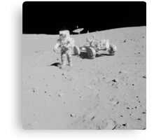 Apollo 15 astronaut walks away from the Lunar Roving Vehicle. Canvas Print