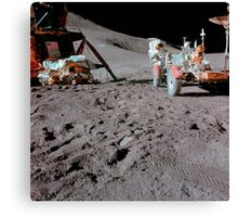 Apollo 15 astronaut works at the Lunar Roving Vehicle on the moon. Canvas Print