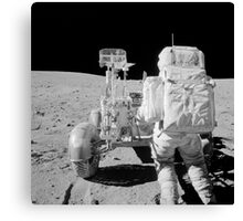 Apollo 16 astronaut reaches for tools in the back of the Lunar Roving Vehicle. Canvas Print