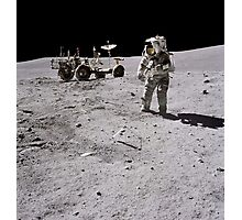 Apollo 16 astronaut collects samples on the lunar surface. Photographic Print