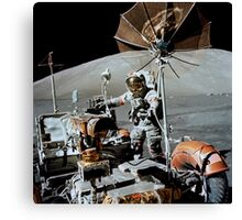 Apollo 17 astronaut approaches the parked Lunar Roving Vehicle. Canvas Print