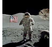 Apollo 17 astronaut stands near the American flag on the lunar surface. Photographic Print