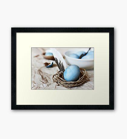 Blue easter egg in a twine nest  Framed Print