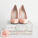 Blush heels and floral books  by Caroline Mint