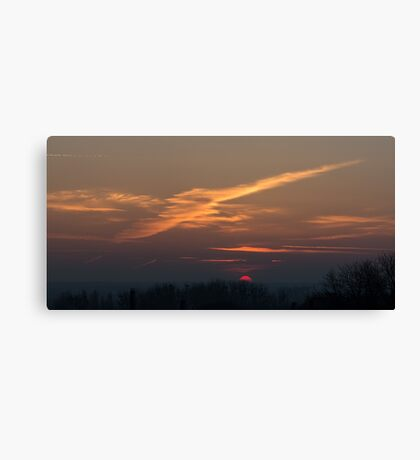Intersecting clouds sunset Canvas Print