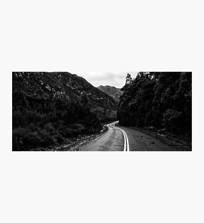 Road and mountains in the Tasmanian countryside. Black and white. Photographic Print
