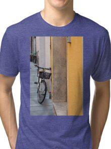 Bike near a yellow wall in Foligno, Italy Tri-blend T-Shirt