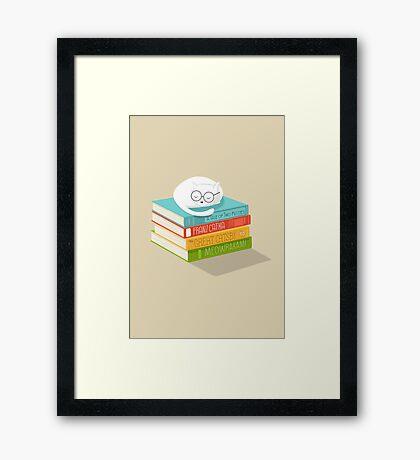 The Cat Loves Books Framed Print