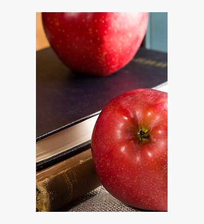 Fragment of old books in hardcover and close-up red apple Photographic Print