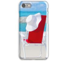 Beach chair with white hat by the ocean iPhone Case/Skin