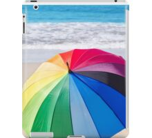 Summer background with rainbow umbrella and flip flops iPad Case/Skin