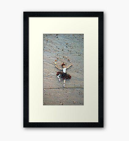 Juggle Framed Print