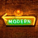 Modern Arrow Neon Sign on Brick Wall by Gregory Ballos