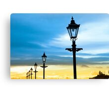 lighthouse and row of vintage lamps Canvas Print