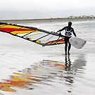 lone Atlantic windsurfer getting ready to surf by morrbyte