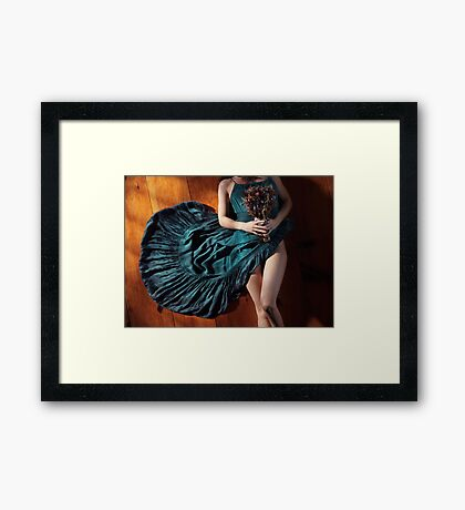 Sensual portrait of woman in blue dress with bare legs holding flowers lying on the floor art photo print Framed Print