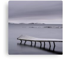 Frozen jetty over water Canvas Print