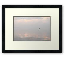 silhouette of a fishing boat on the horizon Framed Print